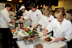 Student chefs in the hospitality and restaurant management program prepare the evening&#8217;s meal.